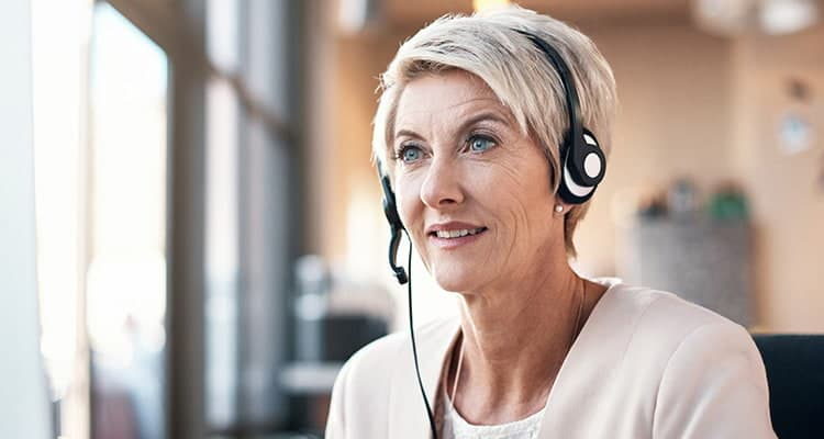 mental health professional talking on a headset