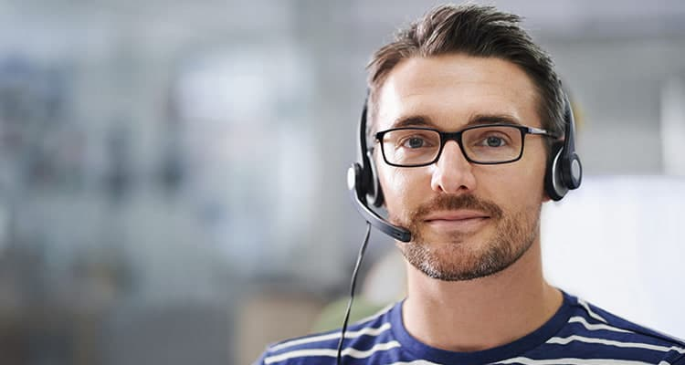 young man wearing a phone headset